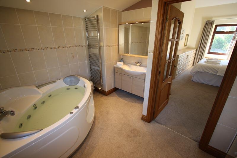 Jacuzzi Bath, Sink of Ensuite Bathroom of the Master Bedroom