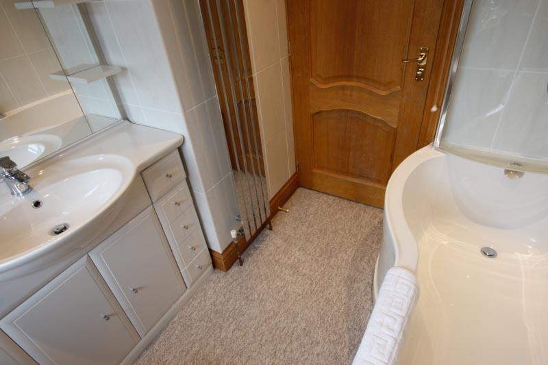 Family bathroom bath and sink