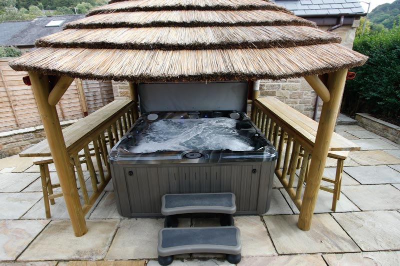 Sheltered hot tub in patio area