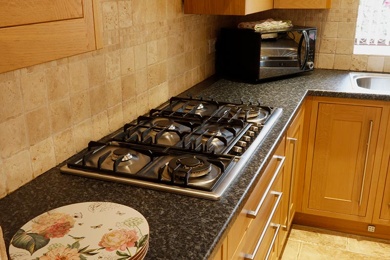 Gas hob and microwave